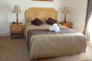 Motel room with queen bed